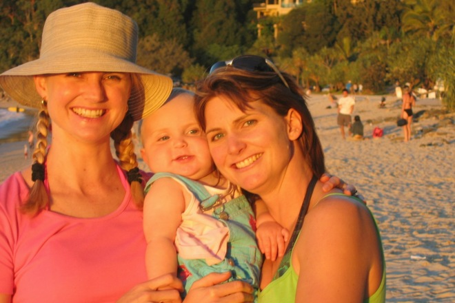 Enjoying the late afternoon sun on Noosa beach with Hannah and baby Sarah