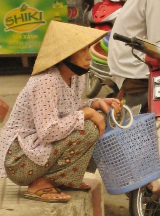 Vietnamese woman with shopping basket