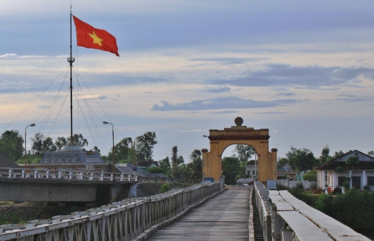 On the Hien Luong Bridge, aka the Peace Bridge. The vehicle bridge is adjacent with the monument on the other side of that