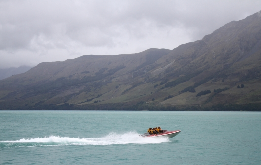A boat speeds off to the Dart River