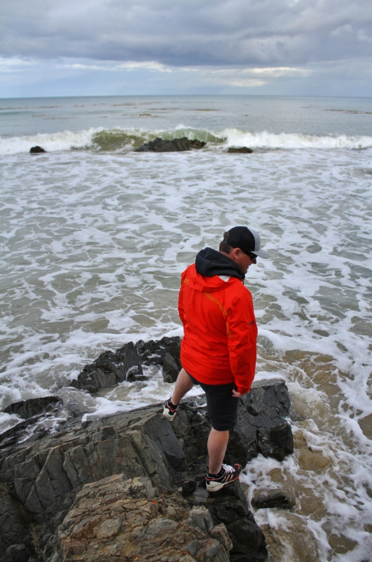 Trying to sneak around rocks on the incoming tide. Mike = win. Me = fail (freaked out by the piddly waves)