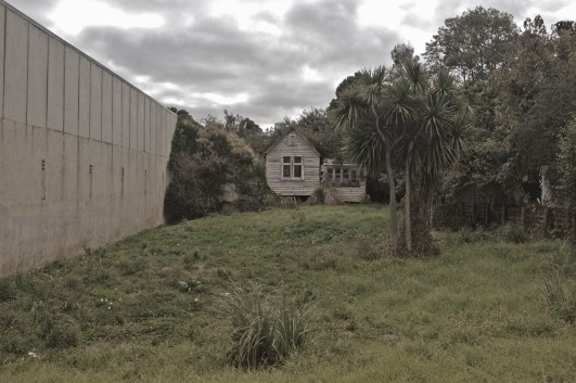 A derelict house beside what used to be the movie theatre
