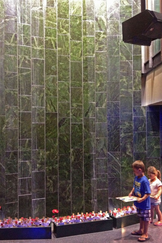 The greenstone wall with water running over it combines with an audio recording of the names of NZ's war dead to form the NZ Roll of Honour