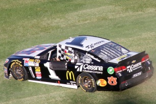 The winner, Jamie McMurray, doing the customary burnouts on track and grass