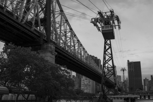 The Queensborough Bridge and tramway from down on Roosevelt Island