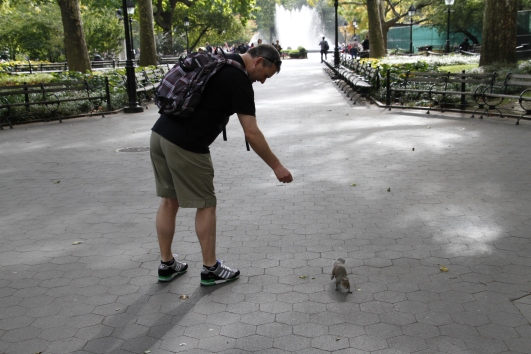 Mike enticing a squirrel to do cute things for the camera