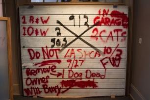 An ex-Katrina garage door in the hurricanes exhibition