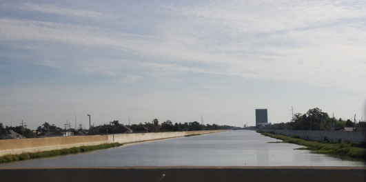 The light coloured concrete section of the left-side levee is where a breech occurred during Katrina