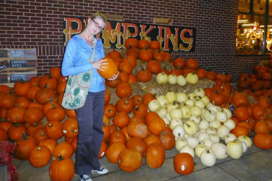 Inspecting yet another huge stack of pumpkins