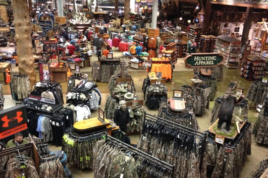 Inside the massive Bass Pro Shop. Along the same lines as 'Where's Wallie?', Mike is down there somewhere - wearing the head cover from a ghillie suit.
