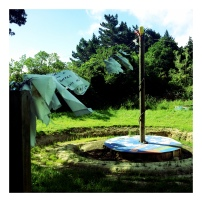 Koru garden sculpture adorned with wishes