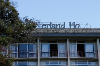 "On the way I noticed the ""erland Ho"", or presumably back when it was newer, the Geyserland Hotel"