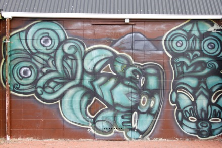 Painted tikis on the toilets at Lake Rotorua