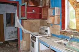 The kitchen and maybe beyond it the laundry. Dad couldn't really remember.