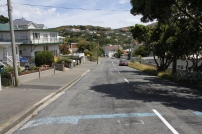 A street in Island Bay. The blue lines appear in several coastal suburbs and indicate the 'safe line' in the event of a tsunami