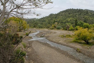 When the Oweka River flooded, it was Dad's job to clear it for crossing again.