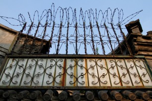 Razor wire in a hutong