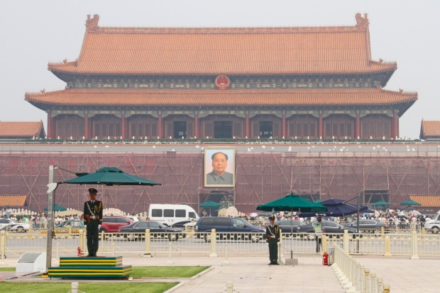 Sentinels around the flagpole. Behind is the Tiananmen Gate through which we'd enter the Forbidden City later.