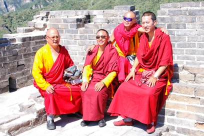 We happened upon a group of monks. They were possibly photographed as much as the wall and were very obliging.