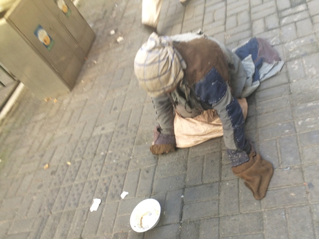 The most challenging sight I came across in China was this beggar. He moved himself along the ground using his arms. Was it genuine or a scam? In some places you need to take everything with a grain of salt. In any case, it's a pretty sad desperate way to make a bit of money.