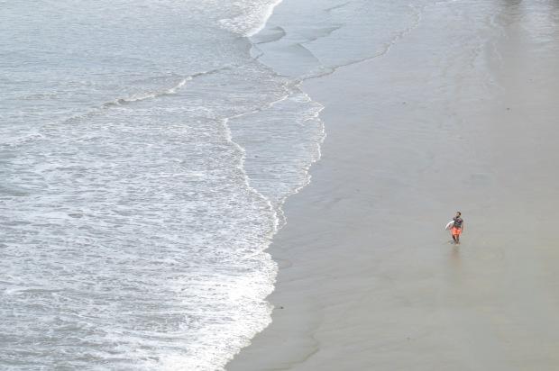 surfer at orewa