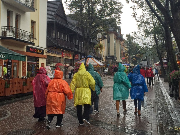 When the rain starts, stall vendors must pull out the boxes of cheap colourful pointy-head ponchos!