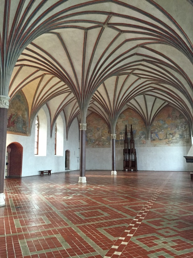 The Great Refectory was used for banquets. Visible on the floor are vents for the the original underfloor heating system which was set up in the more important rooms
