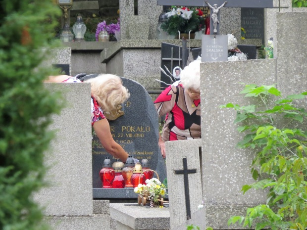 I have never seen a cemetery where so many people were not only visiting but also tending to their loved ones' graves. Maybe that it was a Saturday had some bearing on it. Outside the entry gates several stallholders were set up selling flowers and candles.