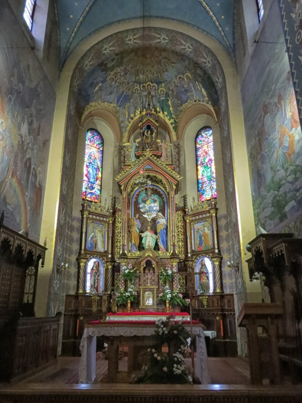 The very colourful high altar in The Parish Church of St. Family