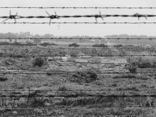 Looking over the fields where buildings were destroyed, to the barracks in Field III
