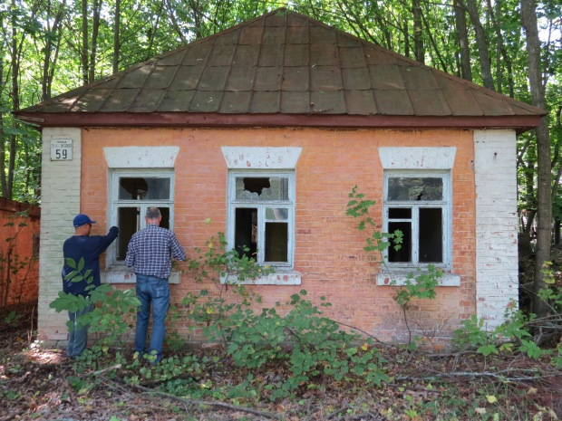 A lot of the abandoned buildings in the zone have been trashed and picked over by looters. Most of that happened after the USSR broke up, during which time the Chernobyl zone wasn't guarded. Windows were also broken to prevent buildup of radiation in enclosed spaces