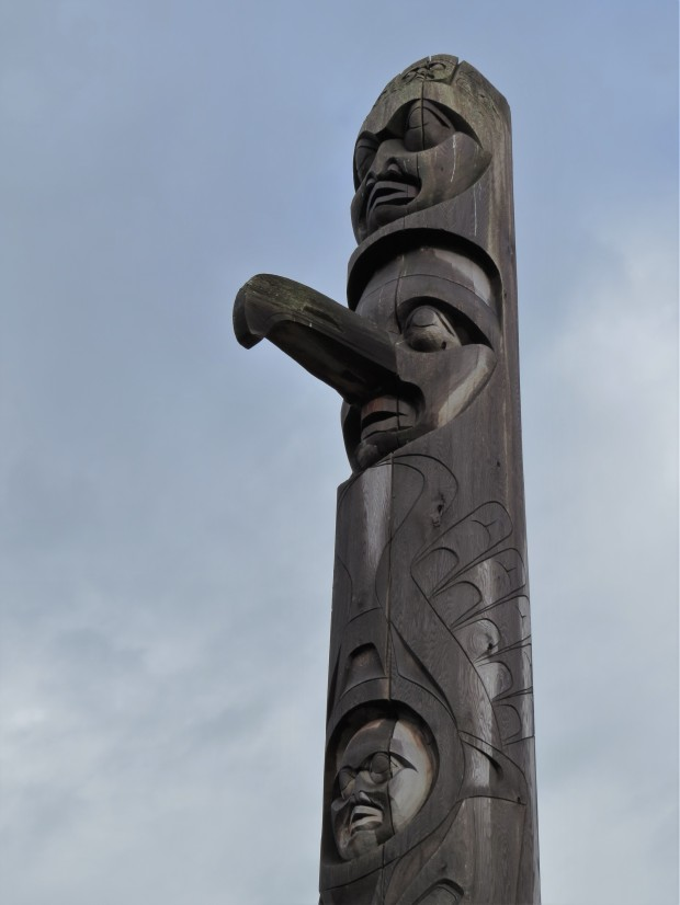 Top of a tall totem pole that symbolises the trauma caused by the residential school system enforced upon First Nations families, and path toward healing.