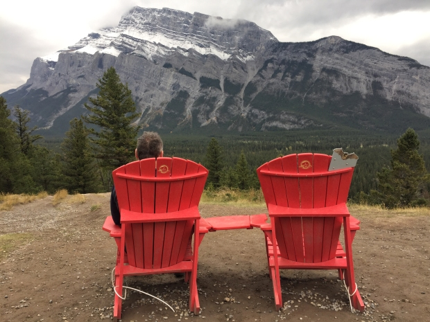 Hello again Mt Rundle. Here on Tunnel Mountain Rd we first waited for a man to set up a tripod for his red chair selfie.